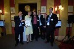 Armando Iannucci (left), Simon Blackwell (third from left), Tony Roche, Ian Martin and Jesse Armstrong receive The Writer's Award from BPG chairman Kate Bulkley